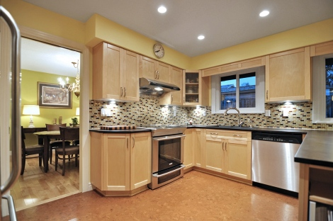 We had help redesigning the kitchen layout with cork flooring, maple cabinets and glass backsplash
