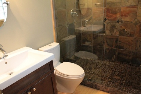 We gutted this bathroom, put in all new fixtures, custom tiled the walls and added a glass wall