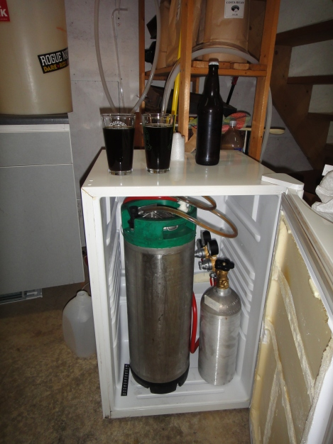 In this mini bar fridge, there is room for two kegs and the CO2 tank.  this whole contraption will be housed in our crawl space with tap lines running up through the kitchen wall.