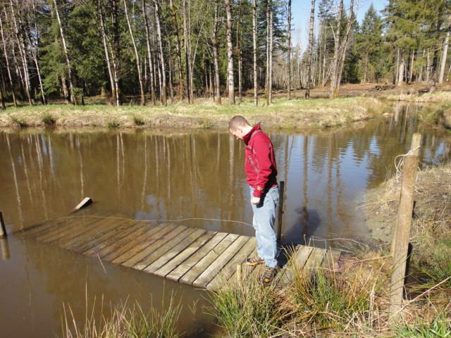 Pond platform along a rural path for Floating fishing platform